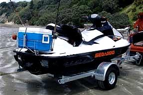 Jet ski hire auckland jetski the hauraki gulf on a sea for Jet ski fishing accessories